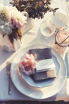 Table setting with dahlias and pinstripes via Homelife. Photography by Corrie Bond. Styling by Lara Hutton.