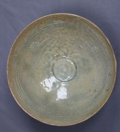 Ancient Korean Goryeo (or Koryo) Dynasty Ceramic Gray Stoneware Porcelain Celadon Bowl with 3 Incised Chrysanthemum Flower Designs (One of Pair); Korea, Circa 918- 1392 CE. Traditional Korean Gray Stoneware Porcelain Is One Of The Major Attributes Which Differentiates Goryeo Ceramics From Those of Their Song Dynasty Contemporaries.