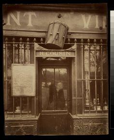 Au Tambour, 63 quai de la Tournelle (1908) by Eugéne Atget
