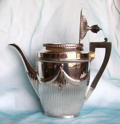 Coffee pot.Sheffield 1895 made by William Gibson and John Lawrence Langham who worked for Goldsmiths & Silversmiths Co in Regent Street.Weight 598g Sterling Silver.
