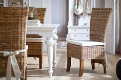 A casual yet chic dining chair realized in hand woven rattan encasing a solid mahogany curved frame. The dark natural tones contrast elegantly with the included seat cushion. Tie backs smartly keep th Rattan Dining Chairs, White Dining Table, Quality Furniture, Provence, Seat Cushions, Sweet Home, Salsa, Interior, Ibiza