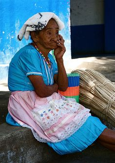 Women in El Salvador. She reminds me of my grandmother.  I also love the pastel colors!