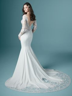 A gorgeous long-sleeved sheath wedding dress in a perfect balance of classic and contemporary trends. Illusion lace in a full-coverage bodice give this a veiled-unveiled kind of vibe. Maggie Sottero Wedding Dresses, Wedding Gowns With Sleeves, Long Sleeve Wedding, How To Dress For A Wedding, Fairy Wedding Dress, Wedding Dress Pictures, Bridal And Formal, Sophisticated Bride, Bridal Boutique