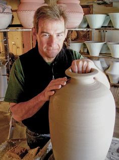 Photo of Mark Skudlarek in his studio. Cambridge Wood-Fired Pottery.    One of the Eight Studio Potters of the Clay Collective. Cambridge Wood-Fired Pottery is located at 10 Tranquil Lane in Cambridge, WI. The studio will be open during The Clay Collective Pottery Tour on May 4 & 5, 2013. http://www.theclaycollective.org Guest Potters: Mary Pratt, Delores Fortuna, and Susan and Eric Anderson