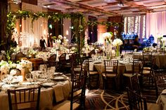 A magical garden scene awash in soft candelight transformed the ballroom at this @Four Seasons Hotel Baltimore wedding.