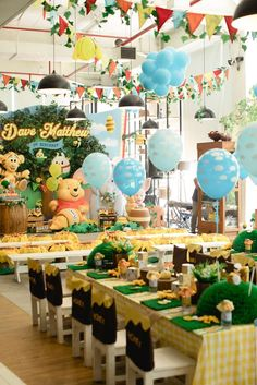 The party decorations and table settings at this Winnie the Pooh Birthday Party are amazing!! See more party ideas and share yours at CatchMyParty.com #winniethepooh #1stbirthdayparty