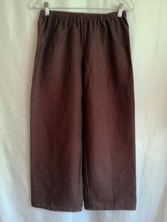 "This is a basic pair of peasant pants. It is a perfect item for a Men's Peasant Renaissance Faire outfit. It is made of linen. It has an elastic waistband. It is available in size XSmall. The pants are 36"" in length, but can be custom made to any desired length."