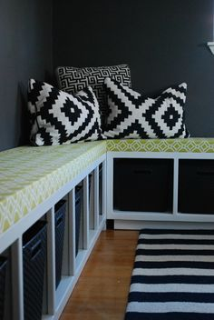 Using Ikea Expedit benches with cushions on top for an entryway area with a pop of color & storage.
