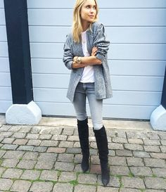 Pernille Teisbaek wears a white t-shirt, gray jacket, skinny jeans, and knee-high suede boots