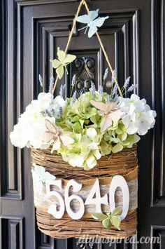 Door Decoration: One Basket Four Ways- buy one basket and change it to fit any holiday, special occasion, or season.