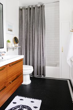 Beautiful and impressive bathroom reno with classic elegance plus midcentury modern, quirky touches!