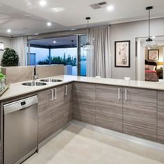 Enhance a kitchen design with texture look cabinets. This will add layers to the overall space. Display home by In-Vogue Homes 'The Waterford'  http://www.in-vogue.com.au/  #WeeklyHomeTrends #NewHomeDesign #Kitchen #Design #HomeDecor #Styling #Interiors #Cabinets #Benchtop