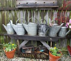 These old watering cans are easy to find at local flea markets!