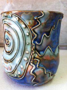 cone 6 stoneware with slip trailing coyote glazes