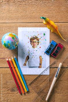 Back to school background. A little boy photography with different school objects. by BONNINSTUDIO | Stocksy United