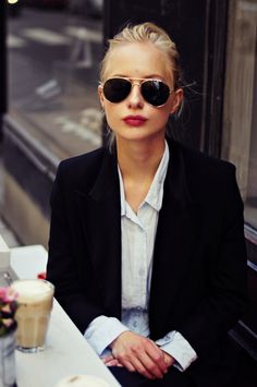 berry lips, those sunglasses, casual button-down with the sleeves peeking out of a blazer, hair pulled back, and no jewelry