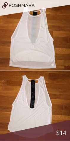 Victoria's Secret workout tank Super cute white workout tank with strap down the back. I love the design it's just a little too big :( bought off here and only tried on. Victoria's Secret Tops Tank Tops