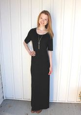 Basic Black Maxi Dress with side slit This classic black maxi dress can be worm year round. It has a side slit that adds a little sass without coming too high. The bottem half has an extra lining for comfort. Pair this dress with our brown leather jacket and a long necklace to complete your look. White Barn Boutique