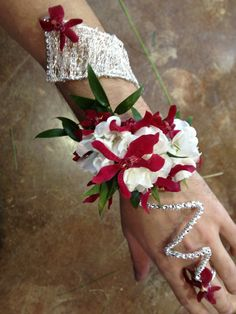 Arm Corsage - wire and rhinestone ring and wrap bracelet combo ; stock flourets and red orchids