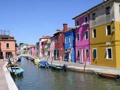 Burano, Bay of Venice, Italy -  one of the small islands in the Bay of Venice where all of the tiny houses are painted different colours and the only way on or off the island is via Vaporetti (a water bus)