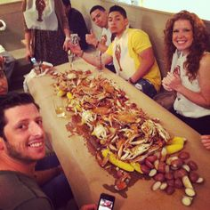 """Our staff at the Oyster Bar getting their """"Crabucation"""" on how best to crack the crabs.   Our Crab Boil starts Tuesday 5/29 and every Tuesday in Summer.  Bucket of BlueCrabs, potatoes, corn, cornbread for $24.   *While supplies last  www.themermaidnyc.com"""