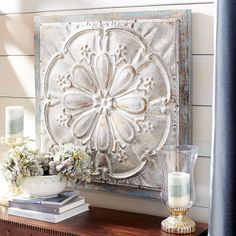 We've taken the look of a Victorian tin ceiling tile and embellished it. Our antiqued, embossed iron medallion is framed with ornate detailing and mounted on gently weathered wood to give it a slightly rustic finish.
