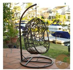 Swing through sunny days in this sturdy outdoor wicker chair. The weather-resistant metal frame ensures stability, while the plush cushion provides comfortable seating and enhances the look of your patio area Add a fun and comfortable touch to your yard with this outdoor swinging egg chair. This wicker chair is weather and UV resistant.