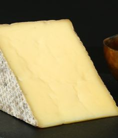 The rind of Thomasville Tomme has hints of forrest floor earthiness, but the paste is creamy and buttery, owing to the fine milk they have at the Sweet Grass Dairy. Not an overly complicated cheese, Thomasville Tomme will slowly unravel in your mouth, like sugar-dusty honey with a lingering tart milky finish.
