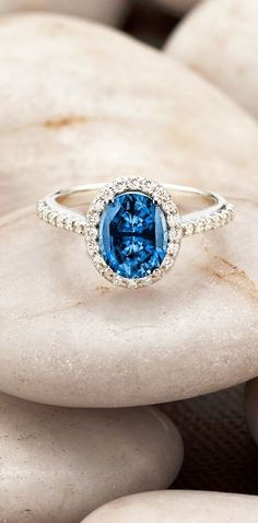 Absolutely stunning sapphire halo engagement ring.