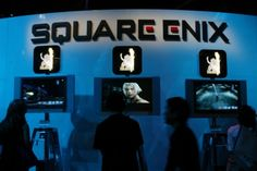 Visitors take to the exhibit floor in front of the Japanese video game publisher Square Enix Co. Ltd. as The Electronic Entertainment Expo, or E3, a trade show for the video game industry, opens in Los Angeles May 12, 2004. Many companies will be introducing new hardware and software titles for fans of video games.