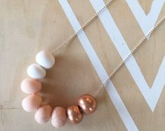 Polymer clay bead necklace. Ombre copper glitter.