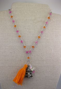 Trendy tassel necklace Little bird charm orange tassel Hot pink and Orange crystals wire wrapped silver plated necklace Happy birdie charm - pinned by pin4etsy.com