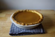 classic pumpkin pie, with a pecan praline sauce for those who aren't purists. Also, this tea towel. I like.