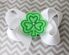 Simple St. Patrick's Day hair bow with shamrock applique and rhinestone accent. $4.00