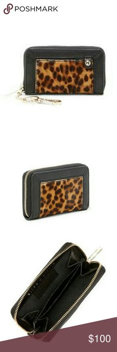 """Last chance! alice + olivia Leather Wallet Brand new with tags! alice + olivia   Genuine Calf Hair Leather Wallet with Keychain  -zip around closure with key chain attachment -genuine Leopard print dyed calf hair and leather -3"""" h and 5"""" w -chain length is approx. 5"""" -calf hair origin: Italy Alice + Olivia Bags"""