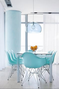 modern white dining room with turquoise chairs, pantone island paradise, light turquoise, baby blue, sky blue, bright blue, caribbean blue, tiffany blue