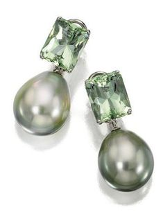 """PAIR OF GREEN BERYL AND CULTURED PEARL PENDANT-EARCLIPS, DONNA VOCK The rectangular-shaped green beryls supporting 2 """"pistachio"""" cultured pearls of natural greenish-gray color, measuring approximately 19.7 by 16.5 mm. and 18.5 by 16.3 mm., mounted in 18 karat white gold, signed DVock, pendants detachable."""