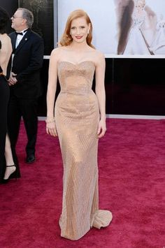 Oscars 2013 Red Carpet Fashion: Jessica Chastain impressed in a custom designed light copper dress by Armani Prive. The actress offset the otherwise nude look with a red lip.