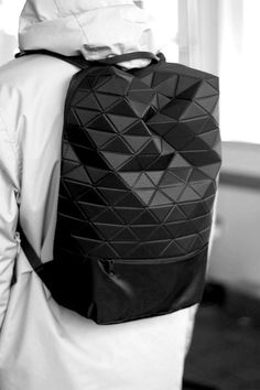 A triangularly Pixelated Structured Black Backpack, would seriously catch anyones attention