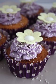 Cuppie Cake with Purple Frosting and White Flower.  Very Pretty