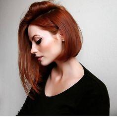 Red hair asymmetrical bob
