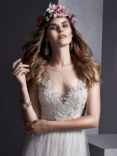 Sottero and Midgley - MELINDA, Flowing tulle over romantic lace combine to create this sheath dress, with stunning illusion neckline and back, adorned with lace appliqués. Swarovski crystal belt accents the waist. Finished with crystal button over invisible zipper closure.