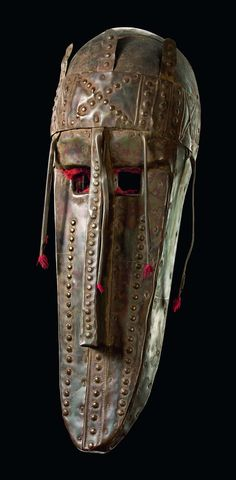 Africa | Mask from the Marka/Marka Soninke people of Mali | Wood, punched metal sheet, five projections with red fringes in the area of nose and temples | all along the Niger this mask type is used for ceremonies associated with fishing and agriculture.