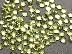 WHOLESALE 10 CTW 25 Pcs 4mm Peridot Round Cut by gemsforjewels