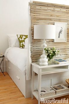 In a 400-square-foot Brooklyn apartment designed by Fitzhugh Karol and Lyndsay Caleo of The Brooklyn Home Company, Ikea's Brimnes bed has drawers underneath, for more storage.