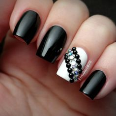 Black and white nails with gemstones and black studs! Instagram media by kimiko7878  #nail #nails #nailart
