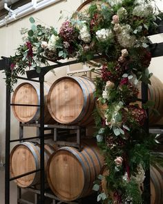 #alobehindthescenes from a beautiful winter wedding at @childresswines!Had so much fun creating this floral structure in the barrel room for the ceremony! While the draping backdrop was not up yet theroom still looked beautiful.#amylynneoriginals
