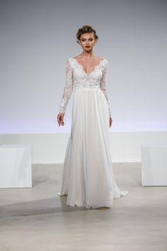 Lena - Blue Willow Bride by Anne Barge. Wedding dress with a chiffon skirt and long sleeve beaded lace bodice.
