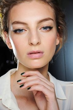 Dolce & Gabbana- Pat McGrath used a swoop of liner and false lashes at the corners of the eyes to create a pretty, feline look.   Photo By Go Runway