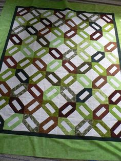 This was called Cuban Cigars ... looks like the Signature Quilt pattern to me.  It is actually finished and in use I just need a new photo
